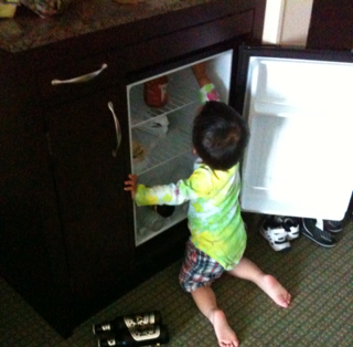 Ryker playing kitchen in the hotel